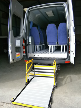 Wheelchair-accessible-minibus-showing-rear-lift-fully-open
