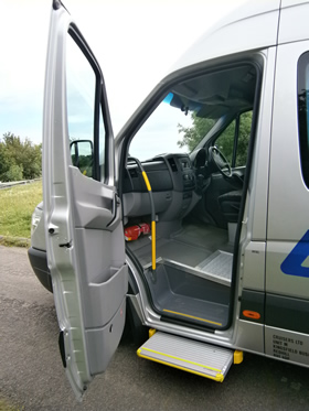 Wheelchair-accessible-minibus-side-door-open